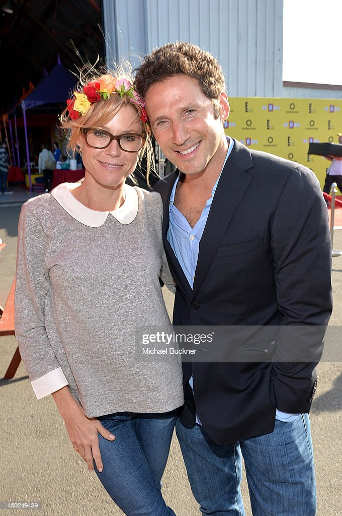 Actress Julie Bowen (L) and actor Mark Feuerstein attend the P.S. Arts Express Yourself 2013 event held at Barker Hangar on November 17, 2013 in Santa Monica, California.