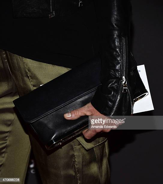 """Actress Julie Bowen, clutch detail, arrives at the Los Angeles premiere of """"See You In Valhalla"""" at the ArcLight Cinemas on April 21, 2015 in..."""