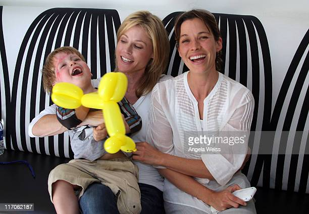 Actress Julie Bowen her son Oliver and actress Brooke Langton attend The Coop and Baby2Baby event for Julie Bowen at The COOP on May 7 2010 in Studio...