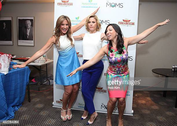 Actress Julie Bowen with Melissa Musen Gerstein and Denise Albert of The Moms attend the Planes Fire And Rescue screening hosted by The Moms at...