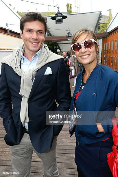 Actress Julie De Bona and Alexis Sure from Lacoste attend Roland Garros Tennis French Open 2013 Day 6 on May 31 2013 in Paris France