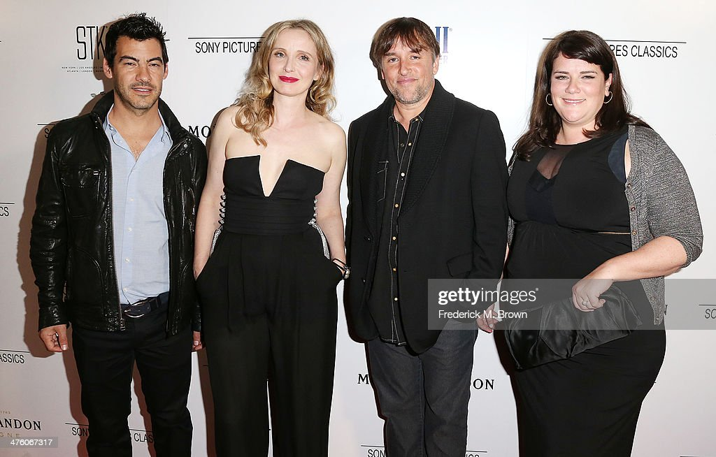 Actress Julie Delpy (L) and director Richard Linklater, and their guest attend the Sony Pictures Classics' 2014 Oscar Dinner at the STK Steakhouse on March 1, 2014 in Los Angeles, California.