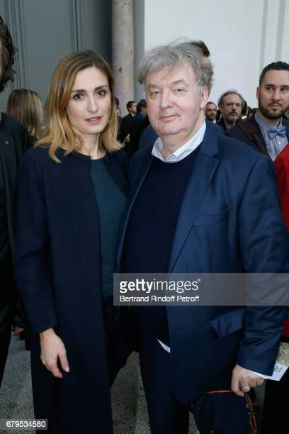 Actress Julie Gayet and Dominique Besnehard attend the 'Revelations' Fair at Balcon d'Honneur du Grand Palais on May 5 2017 in Paris France