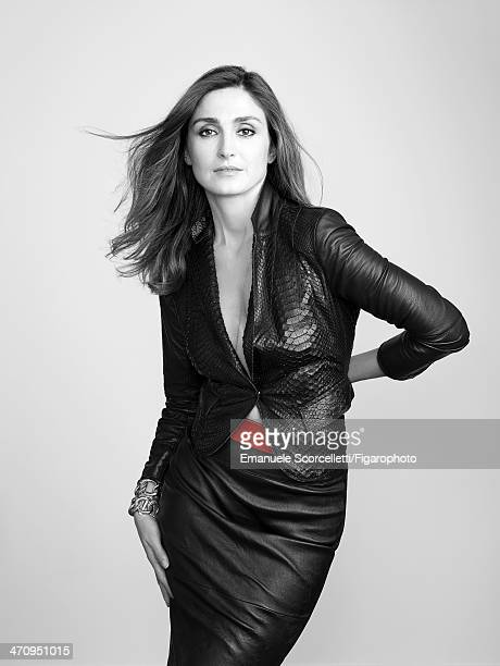 108609002 Actress Julie Gayet is photographed for Madame Figaro on January 8 2014 in Paris France Jacekt skirt belt bracelets personal necklace...