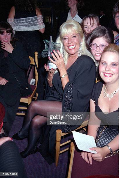 TV actress Julie Goodyear shows off her Lifetime Achievement Award at the UK National Television Awards in Wembley Arena 29th August 1995