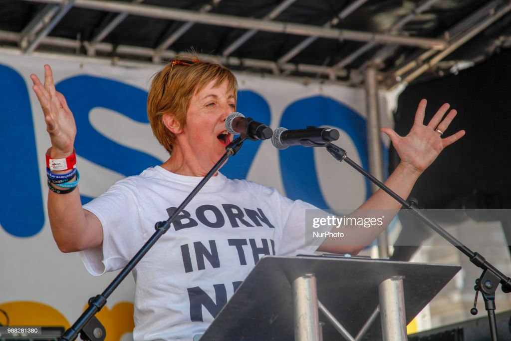 """Actress Julie Hesmondhalgh speaks at a demonstration and celebration march to mark the 70th anniversary of the National Health Service (NHS), in central London on June 30, 2018. Tens of thousands of people braved hot weather Saturday to march through London to """"celebrate and demonstrate"""" over Britain's National Health Service (NHS), ahead of its 70th birthday next week."""