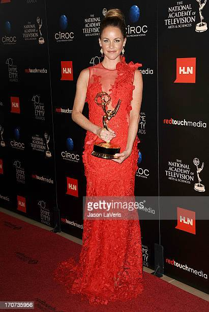Actress Julie Marie Berman poses in the press room at the 40th annual Daytime Emmy Awards at The Beverly Hilton Hotel on June 16 2013 in Beverly...