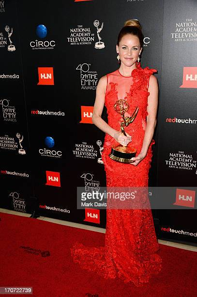 Actress Julie Marie Berman poses with the Outstanding Supporting Actress In A Drama Series award for 'General Hospital' in the press room during The...