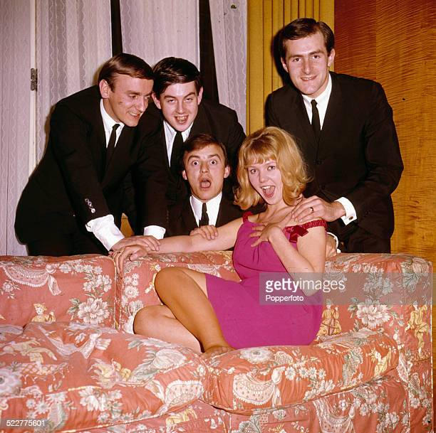 Actress Julie Samuels star of the film 'Ferry Cross the Mersey' posed with pop group Gerry and the Pacemakers in 1964 From left to right Freddie...