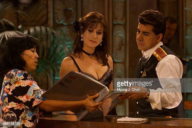 Actress Julieta Rosen and actor Daniel Celario review a scene with stage manager Karen Ueda during a recent taping of Telemundo's new TV show Viva...