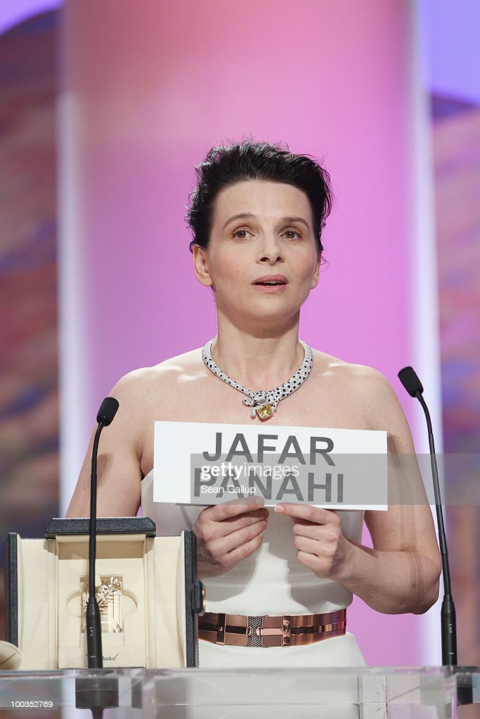 Actress Juliette Binoche holds a sign reading the name of Iranian director Jafar Panahi after winning the Best Actress award for her role in 'Certified Copy' (Copie Conforme) during the Palme d'Or Award Ceremony held at the Palais des Festivals during the 63rd Annual Cannes Film Festival on May 23, 2010 in Cannes, France.