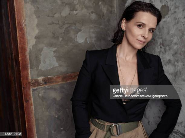 Actress Juliette Binoche is photographed for Madame Figaro on December 13 2018 in Paris France Jacket pants and belt bra earrings and chain Makeup by...
