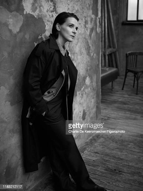 Actress Juliette Binoche is photographed for Madame Figaro on December 13, 2018 in Paris, France. Trench coat, jacket, shirt and pants , earrings ,...