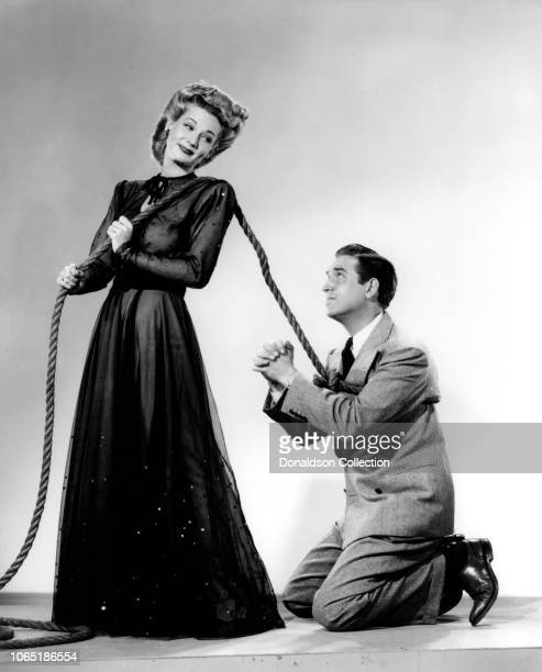 Actress June Allyson Robert Paige in a scene from the movieHer Primitive Man