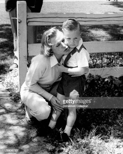 Actress June Allyson with her son Richard Powell Jr at home in 1954