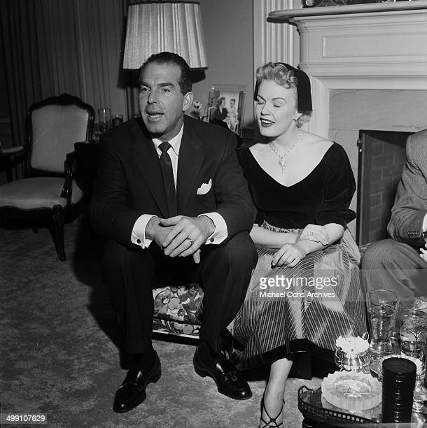 Actress June Haver and husband actor Fred MacMurray attend a party in Los Angeles California