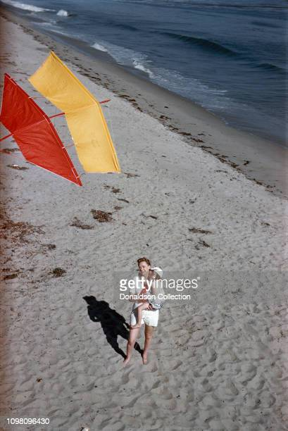 Actress June Lockhart flies a kite with her daughter Anne Maloney on June 19 1957 in Los Angeles California