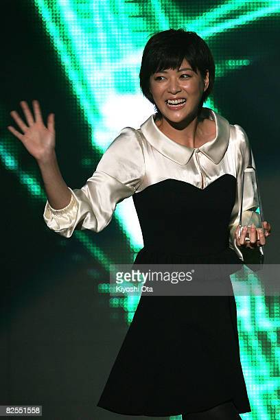 "Actress Juri Ueno waves to fans after receiving the Best ""Student Voice"" Actress award during the MTV Student Voice Awards 2008 at Shinkiba Studio..."