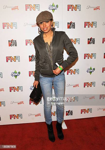 Actress Jurnee Smollett arrives at the Friends And Family GRAMMY Event at Paramount Studios on January 29 2010 in Los Angeles California
