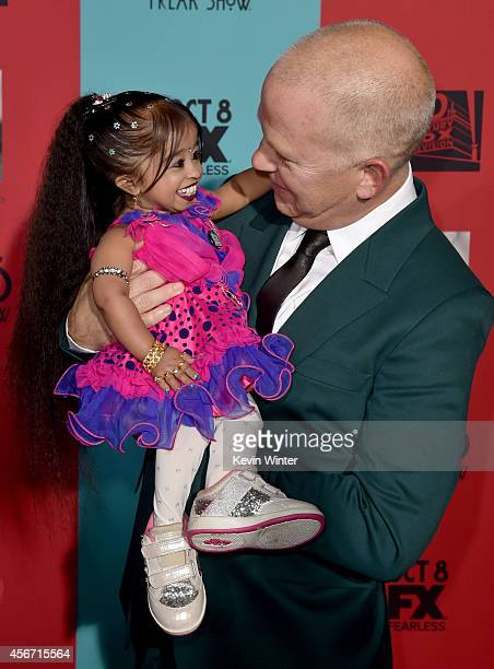 Actress Jyoti Amge and cocreator/executive producer/writer/director Ryan Murphy attend the premiere screening of FX's American Horror Story Freak...