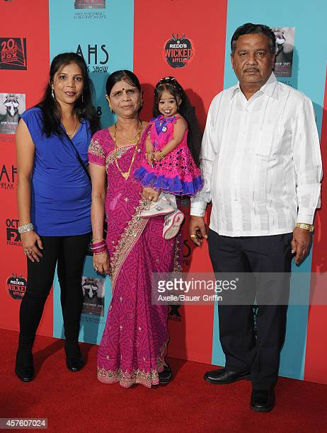Actress Jyoti Amge and family arrive at the Los Angeles premiere of 'American Horror Story Freak Show' at TCL Chinese Theatre IMAX on October 5 2014...
