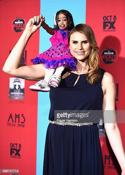 EDITORS NOTE Actress Jyoti Amge with actress Erika Ervin arrives at the Premiere Screening of FX's American Horror Story Freak Show at TCL Chinese...