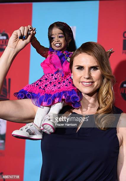 Actress Jyoti Amge with actress Erika Ervin arrives at the Premiere Screening of FX's American Horror Story Freak Show at TCL Chinese Theatre on...