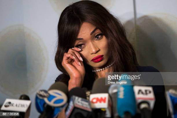 Actress Kadian Noble wipes away tears as she discusses her experiences with Harvey Weinstein during a press conference to announce the filing of a...