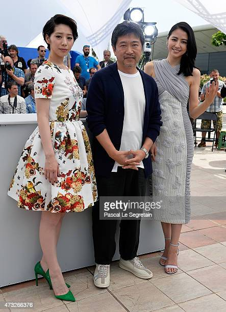 Actress Kaho director Hirokazu Koreeda and actress Masami Nagasawa attend a photocall for 'Umimachi Diary' during the 68th annual Cannes Film...