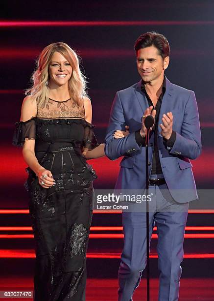 Actress Kaitlin Olson and actor John Stamos speak onstage during the People's Choice Awards 2017 at Microsoft Theater on January 18 2017 in Los...