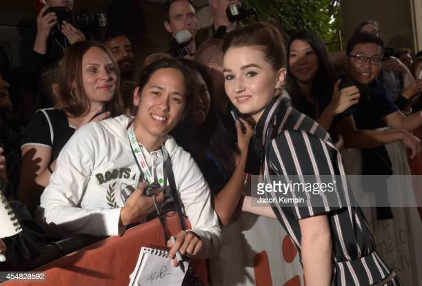 Actress Kaitlyn Dever poses for a selfie with a fan as she attends the Gala Screening of Paramount Pictures' 'MEN WOMEN CHILDREN' during the 2014...