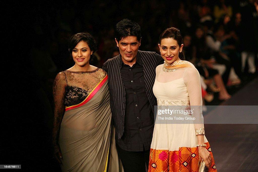 Actress Kajol and Krishma Kapoor walk the ramp wearing creations of designer Manish Malhotra during Lakme fashion week 2013 in Mumbai on March 22 2013