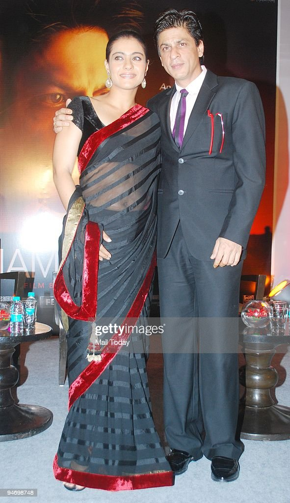 Actress Kajol with actor Shah Rukh Khan during a first look screening for the movie `My Name is Khan` in Mumbai on Wednesday December 16 2009