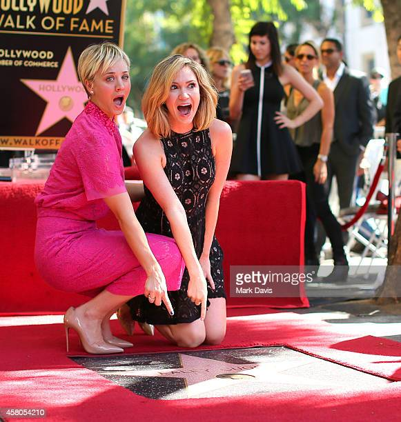 Actress Kaley Cuoco and Ashley Jones pose with a walk of fame star dedicated to Kaley Cuoco on the Hollywood Walk of Fame on October 29 2014 in...