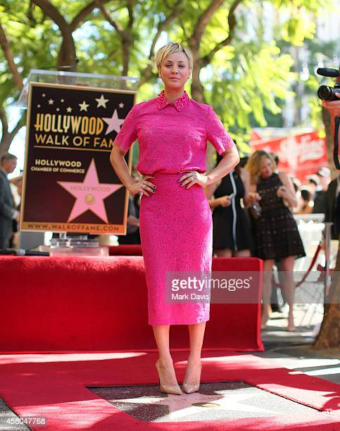 Actress Kaley Cuoco poses with her star on the Hollywood Walk of Fame on October 29 2014 in Hollywood California