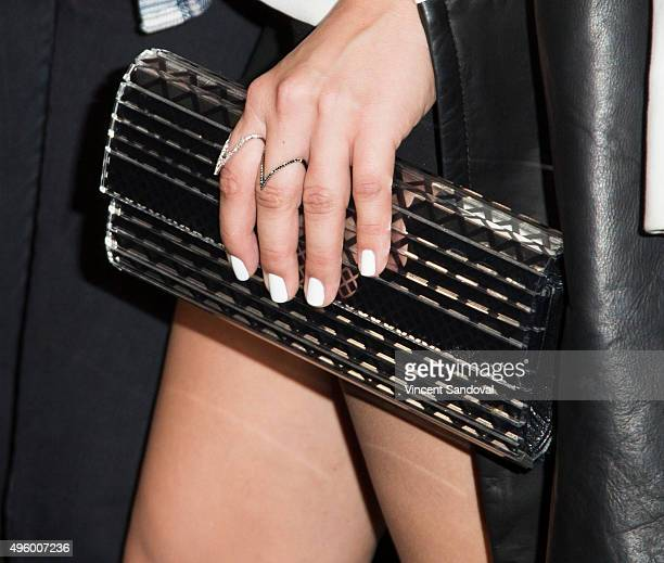 Actress Kaley Cuoco purse detail attends the Fallout 4 video game launch event in downtown Los Angeles on November 5 2015 in Los Angeles California