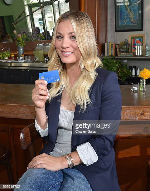 Actress Kaley Cuoco shows off her Visa credit card during a video shoot for the new Uber Local Offers program on August 9 2016 in Los Angeles...
