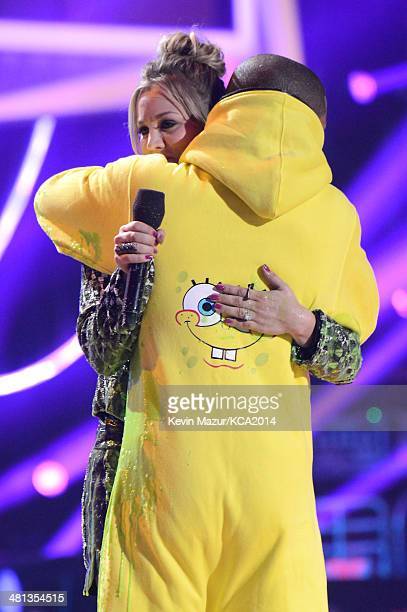 Actress Kaley CuocoSweeting and musician Pharrell Williams embrace onstage during Nickelodeon's 27th Annual Kids' Choice Awards held at USC Galen...