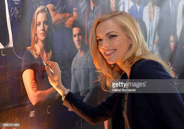 Actress Kara Kilmer signs a poster as she attends a press junket for NBC's 'Chicago Fire' 'Chicago PD' and 'Chicago Med' at Cinespace Chicago Film...