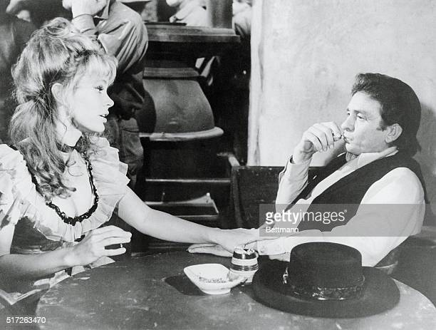 Actress Karen Black as a bar girl invites singer Johnny Cash as exgunman Abe Cross to spend the evening with her in the new Paramount picture A...
