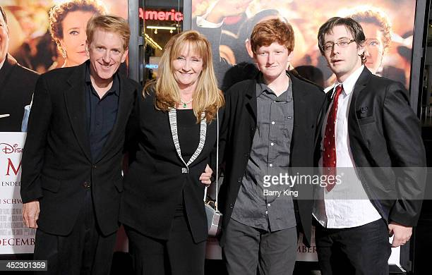Actress Karen Dotrice husband Edwin Nalle and sons Griffin Nalle and Garrick HydeWhite arrive at the AFI FEST 2013 'Saving Mr Banks' opening night...