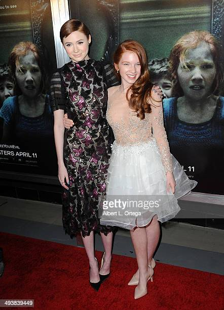 Actress Karen Gillan and actress Annalise Basso attend the Screening Of Relativity Media's 'Oculus' held at TLC Chinese 6 Theatres on April 3 2014 in...