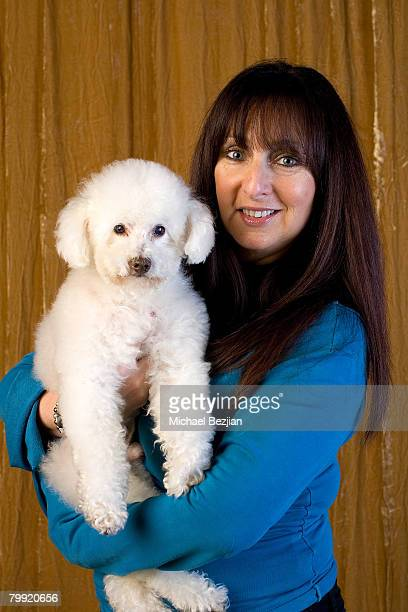 Actress Karen Salkin poses with her dog at the Main Event Red Carpet Lounge and Green Suite on February 21 2008 in Los Angeles CA