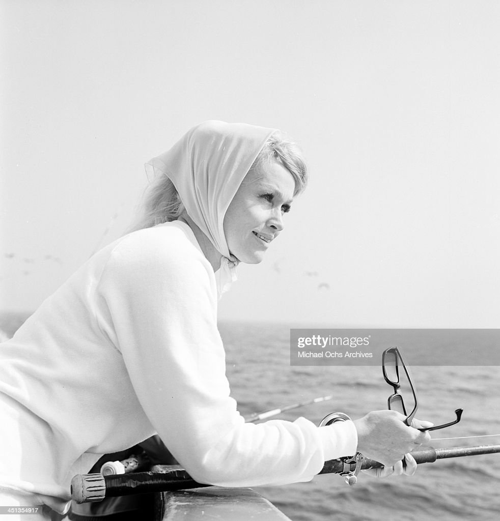 Actress Karen Steele poses as she fishes in Los Angeles