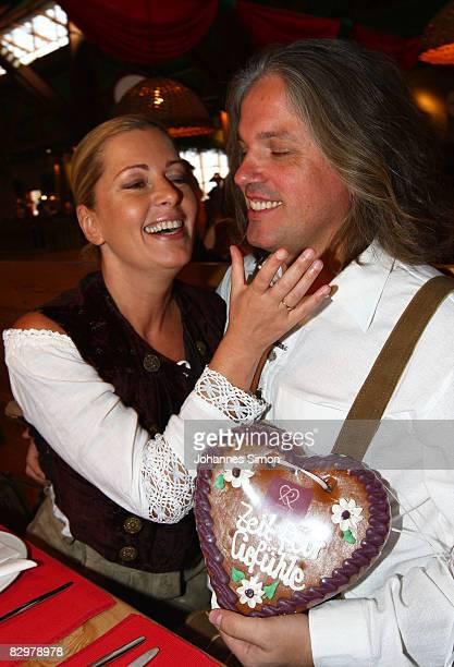 Actress Karin Thaler and her husband Milos Malesevic attend the GoldStar TV Wiesn event at Kuffler's Weinzelt beer tent during day 4 of Oktoberfest...