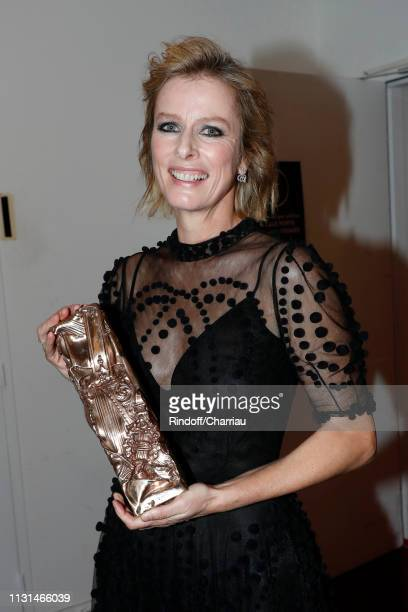 Actress Karin Viard winner of the award for Best Supporting Actress for Les Chatouilles poses during the Cesar Film Awards 2019 at Salle Pleyel on...
