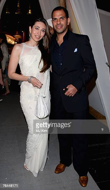 Actress Karisma Kapoor and unidentified guest attend the Jaeger Le Coultre Host Celebration Party in Venice during day 3 of the 64th Venice Film...