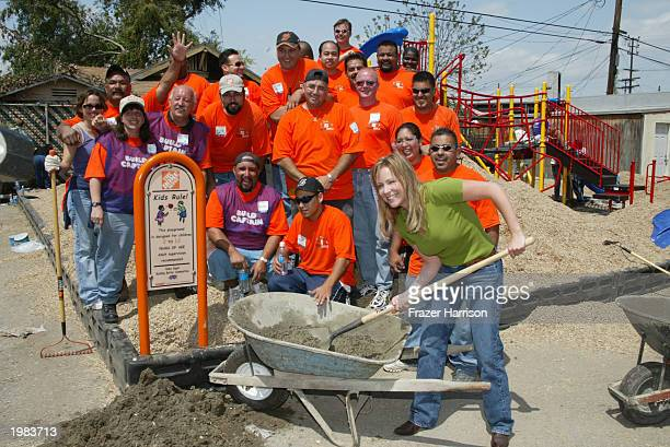 Actress Karri Turner of the television series JAG helps build a playground at the St Columbkille School in Los Angeles May 8 2003 California...