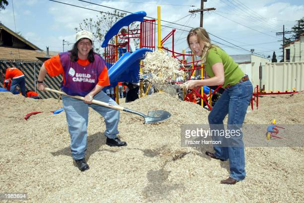 Actress Karri Turner of the television series JAG lends a helping hand to the building of a childrens playground with Home Depot store volunteer KC...