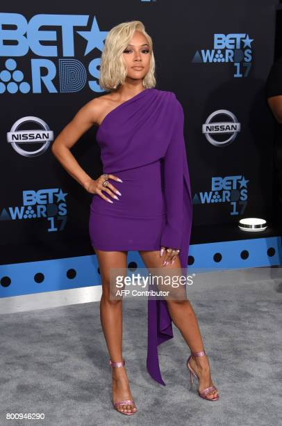 Actress Karrueche Tran poses upon her arrival at the BET Awards ceremony on June 25 in Los Angeles California / AFP PHOTO / CHRIS DELMAS